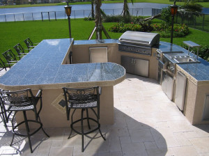 custom outdoor kitchen is the largest island